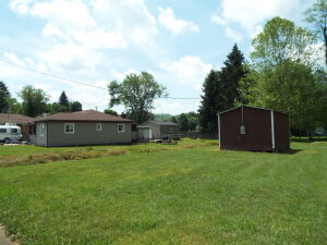 3 Bedroom Home & Outbuildings on Level Lot