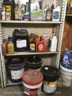 Assortment of partial jugs fluid. I.e. transmission, oil, brake, power steering, etc.