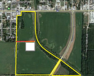 63.5 acres m/l located on Hwy 412 E and the Hwy 412 Bypass