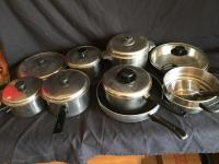 Variety of fry pans, pots & pans  (Several with lids)