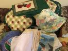 Variety of table cloths, placemats, napkins, dish towels, seat cushions, etc.