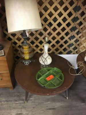 Round table with food display and 2 lamps