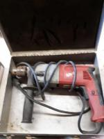 Porter-Cable metal box with a Milwaukee heavy duty hammer drill - 1/2 inch - catalog number 5 3 7 8 - 20