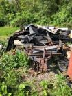 Hauling trailer with large lot of wood