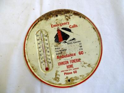 "Johnson Funeral Home, Junction City, Kansas metal thermometer, rusted on top, 6"" diam"