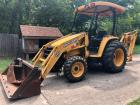 John Deere 110 Diesel 4x4 Backhoe w/Hydraulic Hammer and 7 ton trailer. Only 710 hours!