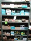 Shelf and contents consisting of miscellaneous bushings, couplings, clamps, shields