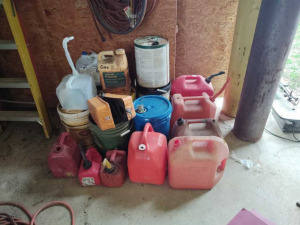 NUMEROUS FUEL CANS & BUCKETS