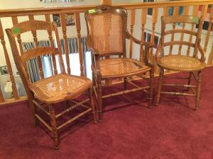 Three very nice chairs-Two ladder back with cane seat and one captains chair fruit & nut style with cane seat and back