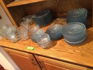 All blue glassware on shelf includes dinner plates, dessert plates, bread and butter plates, cups and saucers, serving platter and serving bowls