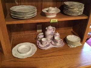 Various pieces of china include dinner plates, bread and butter plates, salad plates and very nice tea set with pitcher, cups, saucers, cream and sugar with serving tray
