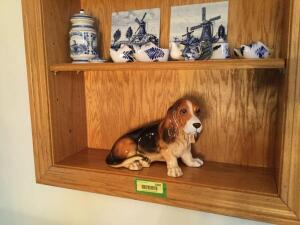 Many Delft blue pieces and Sir Blue the bassett hound