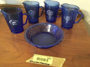 Four Shirley Temple pitcher style cups and one bowl