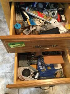 We all have these so why not add more to what you already have. Contents of these junk drawers include caulk, tools, electrical switches, Kodak easy share C813 digital camera, casters, staple gun, window seal, packing tape, hole punch, paper clips and mor