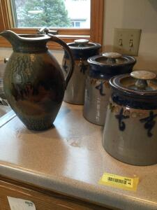 Four pieces of pottery & one pitcher and three canisters