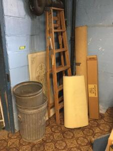 A ladder, 2 trash cans, carpet remnants and 3 fluorescent light fixture diffusers. Plus a roll of banquet table paper covering.