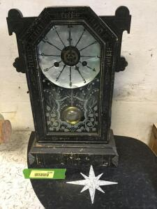 This ol' mantle clock has seen many minutes and hours pass. Its taken its licks, but its got history
