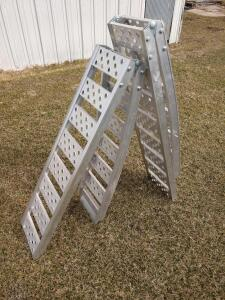 One pair of aluminum approximately 7 ft long folding loading ramps ATV style ramps like new