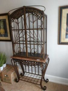 METAL WINE RACK WITH UPPER SHELVING, SHELVING IS GLASS, CONSTRUCTION OF THIS ITEM IS ALL METAL AND LOWER PIECE HAS A COMPOSITE TOP. THIS LOT MATCHES LOT 1003