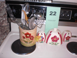 STOVE TOP CONTENTS: POTTERY CONDIMENT SET, CANISTER WITH UTENSILS