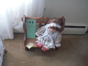 PORCELAIN DOLL W/ WOODEN BENCH
