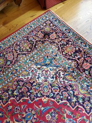 Beautiful area rug and colors of red and blue. Dimensions are 138 x 129. This is a 100% wool rug from Iran.