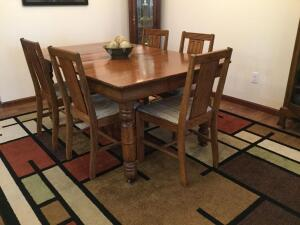 "42"" square oak table with two 11"" leaves and 5 legs with 5 oak straight chairs and decorative bowl"