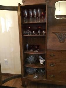 Variety of glassware-mostly stemless wine glasses, some red flashed wine glasses and sherbets, divided plates, clear serving bowls