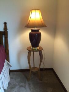 "Small oak lamp table, 3 table lamps (matching neutral tone lamp in basement), and a 28"" x 42"" print double matted paper art piece"