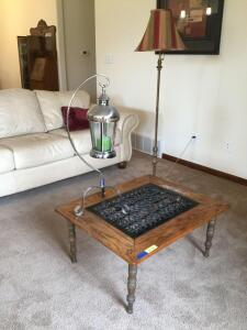 Oak coffee table made from an old heating floor grate, brass looking floor lamp and a modern candle holder hurricane lamp Table measures 26 x 32 x15