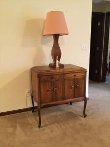 Mahogany lift top cabinet made from radio phonograph Measures 32 x 20 x 30 and has four Queen Anne style legs. single drawer and double doors. Pair of matching walnut handmade lamps