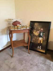 Brett Favre autographed football with letter of authenticity from 1996, other Green Bay Packer related items include ticket stubs, large coffee mug, book, Packer resin train and Brett Favre framed poster measures 26 x 38