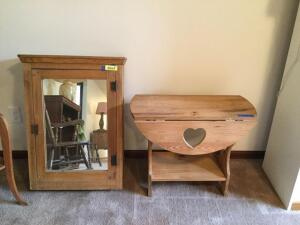 "Antique pine medicine cabinet with mirrored front door Measures 21 x 31 with key taped to it  and a small modern 27"" round drop leaf table"