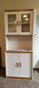 Modern white probably formica kitchen cupboard with storage in top and bottom lights mounted on the side and contents 16 x 29 x 72