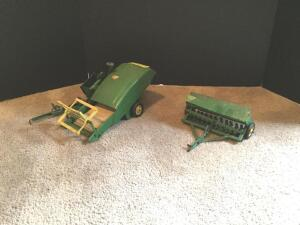 Vintage original John Deere pull-type combine and grain drill, both with metal rims on tires