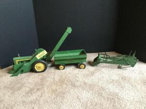 Vintage original John Deere narrow front tractor probably a 50, 60 or 70 with picker with loader and flare box wagon, all with metal rims