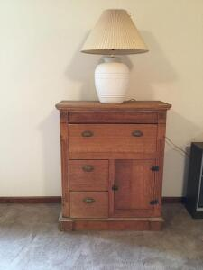 Antique oak cabinet with three drawers and single door measures 15 deep x 33 wide x 40 tall and pair of matching lamps (Second lamp not photoed due to house staging)