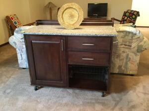 Rolling portable kitchen island with marble top 24 deep x 44 wide x 33 tall dark wood and gray and white top and a fancy gold plate