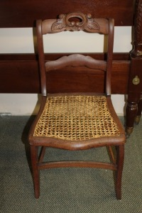 ANTIQUE HAND CARVED CANE BOTTOM CHAIR