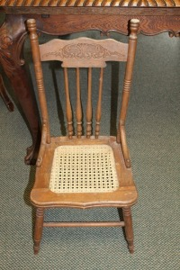 ANTIQUE YOUTH CANE BOTTOM CHAIR