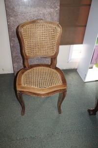 VINTAGE HAND CARVED CANE BOTTOM AND BACK CHAIR