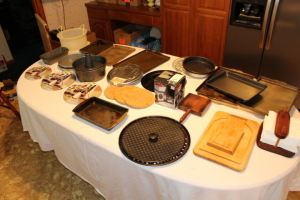 Baking pans, cutting boards, cake pans, misc. lids, napkin holder, scales, misc.