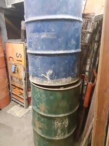 2 metal barrels roughly 3 ft tall both empty