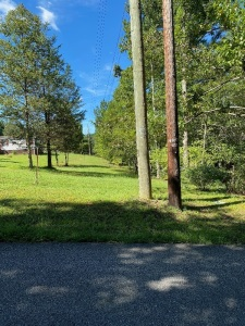 1.04 acres with old unlivable mobile home on Woodale Rd in Knox County (Near Strawberry Plains Exit) Nice level lot in well established community, very close to interstate 40