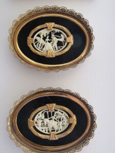 2 Gold framed carvings