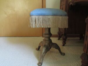 iron stool w/ blue seat