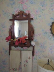 Walnut Cross framed mirror w/ towel bar and candle sticks