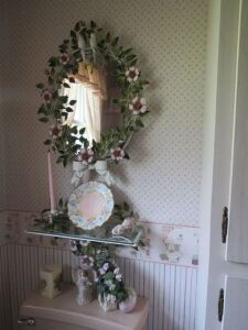 Metal floral mirror w/ glass shelf, china shoe, candle stick & plate
