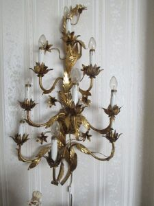 Ornate gold metal wall lamp