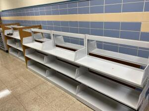 Library shelving unit, currently in sections/ 15 feet in total length